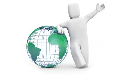 Guy standing over world globe