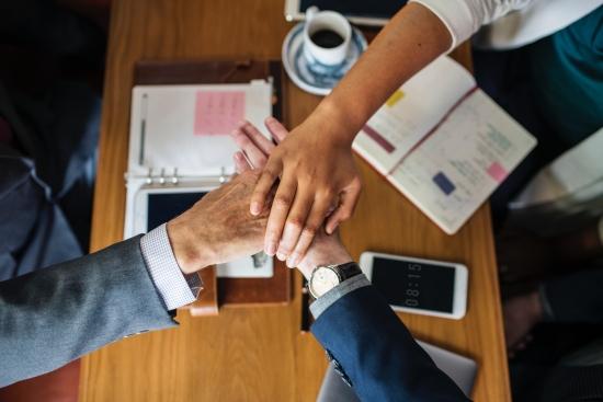 3 hands taking oath